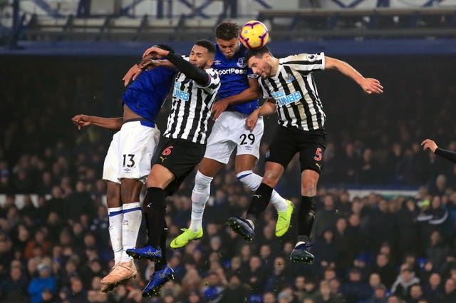 Yerry Mina, Dominic Calvert-Lewin, Jamaal Lascelles and Fabian Schar challenge for the ball