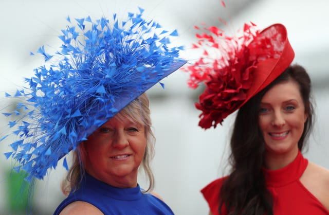 Flamboyant headwear is the order of the day at Aintree (David Davies/PA)