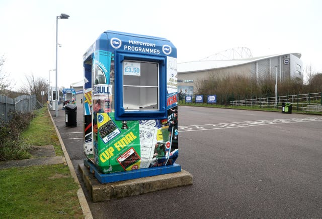 Empty programme stand outside the AMEX Stadium