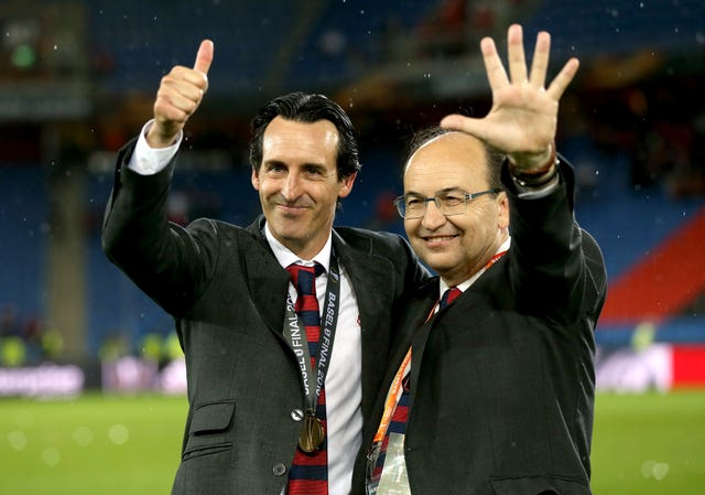 Unai Emery, left, celebrates winning the Europa League with Sevilla in 2016