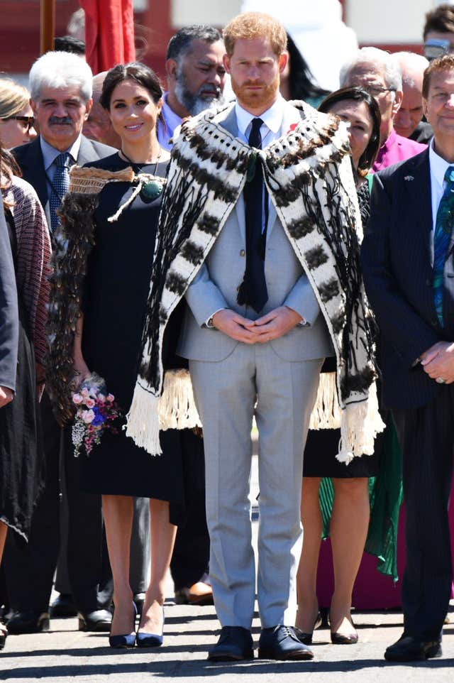 The Duke and Duchess of Sussex wear traditional Maori cloaks called a Korowai during their visit to New Zealand last autumn. Tim Rooke/PA Wire