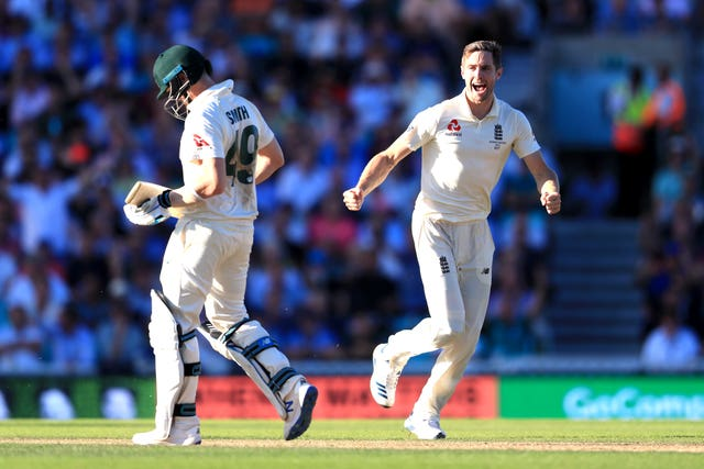 Chris Woakes, right, celebrates the wicket of Steve Smith, left