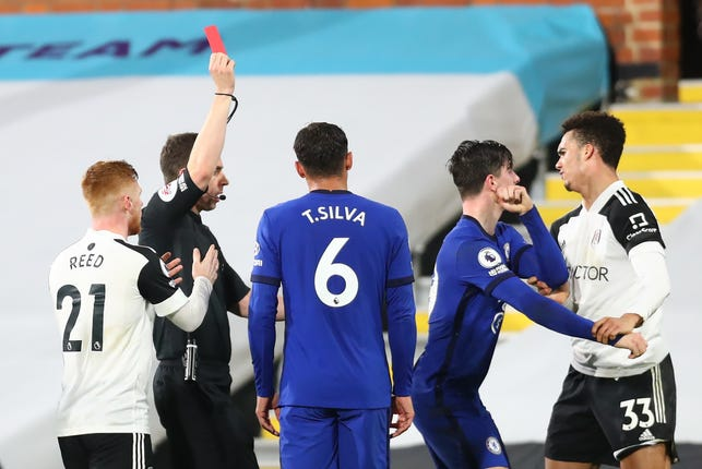 Fulham's Antonee Robinson (right) is shown a straight red card
