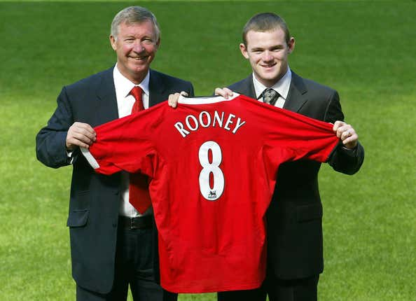 Rooney with Sir Alex Ferguson at a press conference confirming his arrival at Manchester United (Gareth Copley