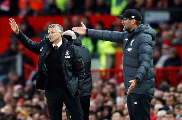 Manchester United manager Ole Gunnar Solskjaer (left) will be hoping to end the winning streak of Liverpool counterpart Jurgen Klopp.