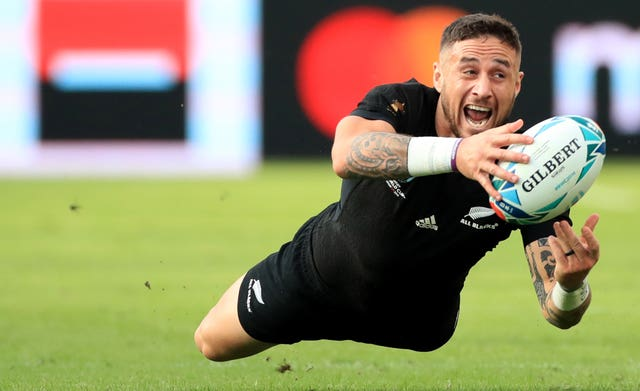 New Zealand's TJ Perenara dives during the match against Namibia