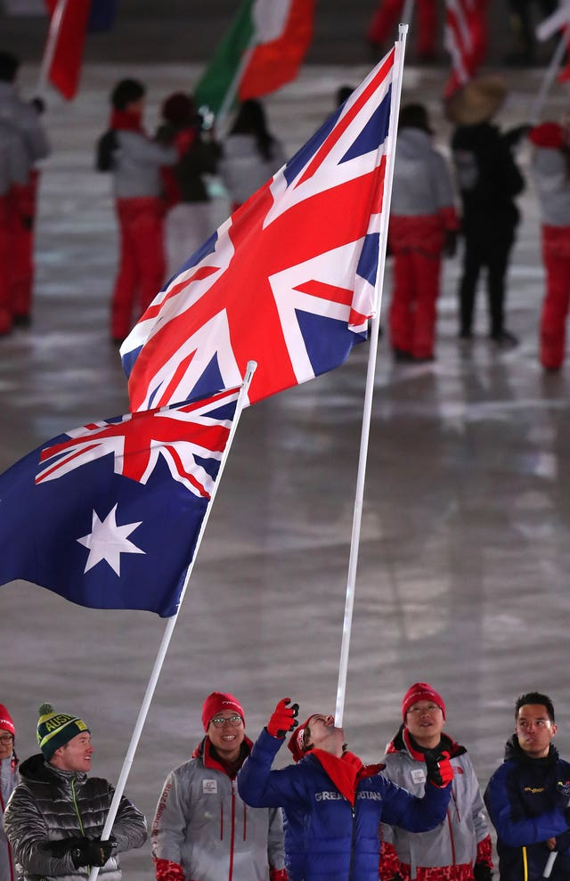 Great Britain's flagbearer Billy Morgan carries the flag on his chin during the closing ceremony of the Pyeongchang 2018 Winter Olympic Games in South Korea