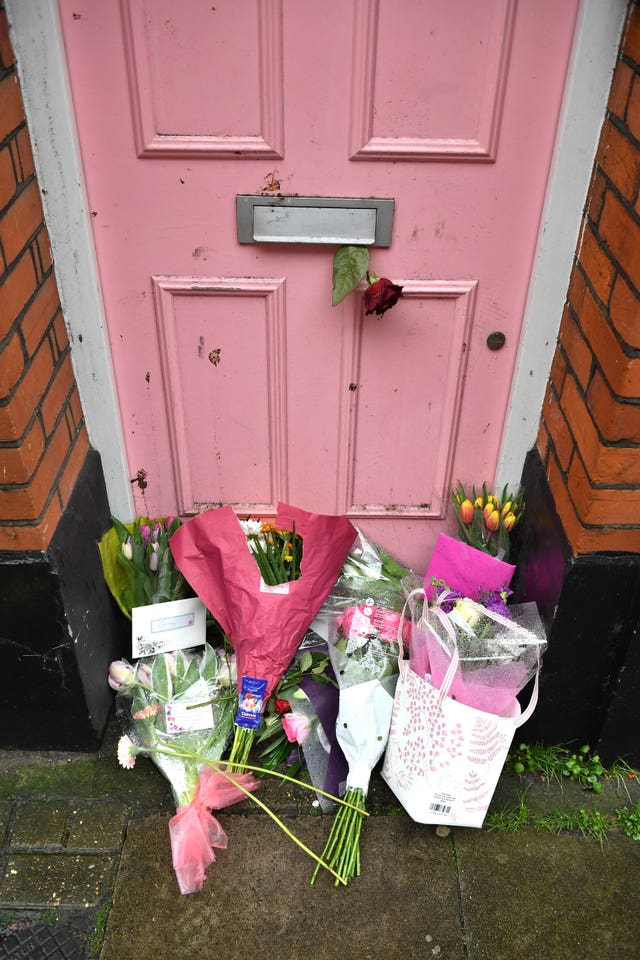 Tributes placed outside Caroline Flack's former home in north London