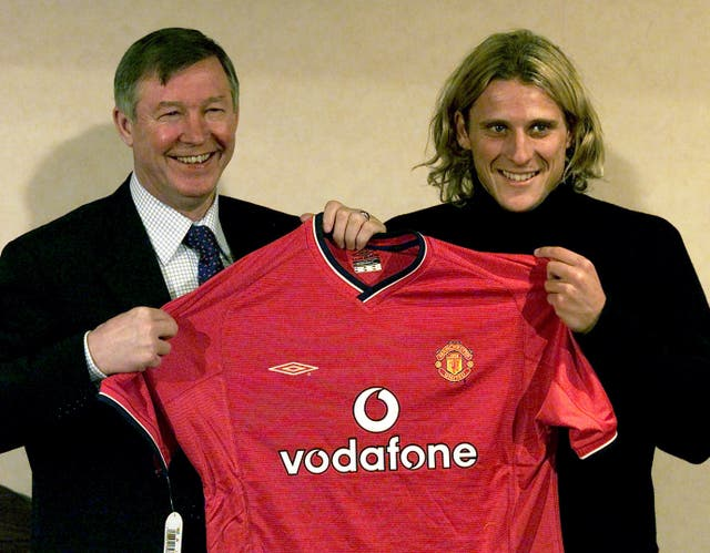 Forlan (right) was brought in by United boss Sir Alex Ferguson (left) on a four-and-a-half year deal (Martin Rickett/PA).