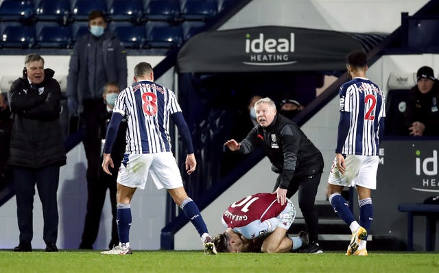 Jack Grealish lies injured after Jake Livermore's red-card challenge