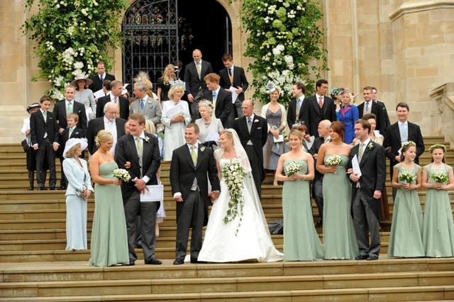 Peter and Autumn Phillips leave St George's Chapel in Windsor after their marriage ceremony (Ian McIlgorm/PA)