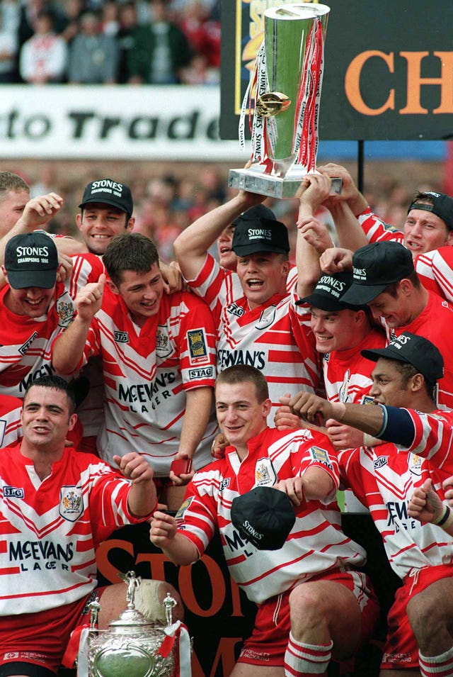 Captain Bobbie Goulding and St Helens lift the Super League Trophy in 1996