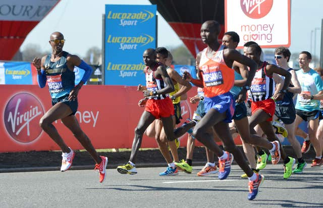 Great Britain's Olympic 5000 and 10,000 metre champion Mo Farah (left) in the 2013 London Marathon