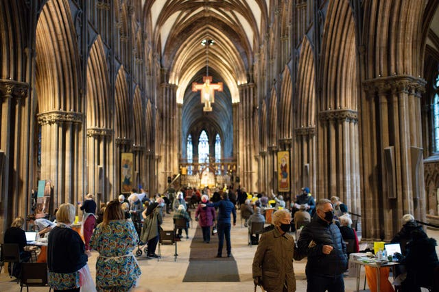 Members of the public at Lichfield Cathedral, Staffordshire, to receive the Oxford/AstraZeneca coronavirus vaccine