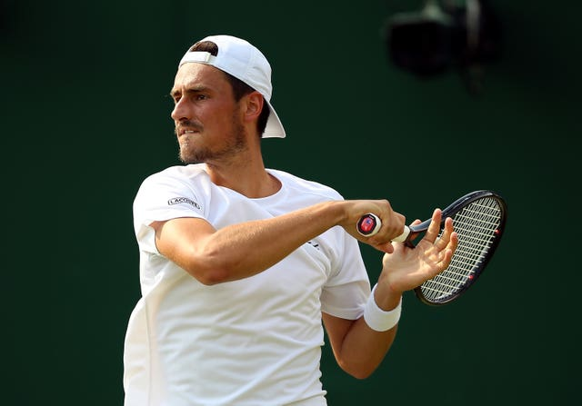 Bernard Tomic hit out at Lleyton Hewitt on the first day of the tournament