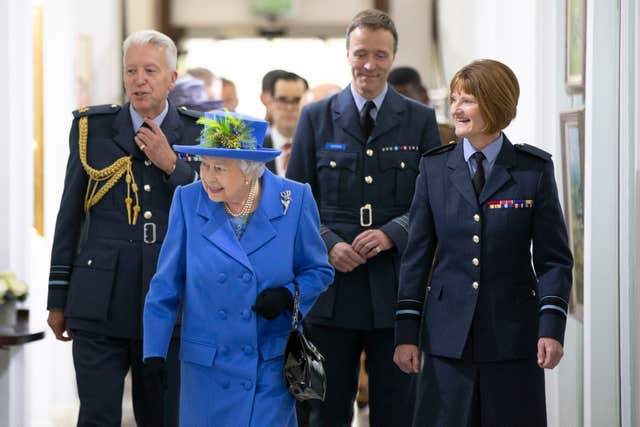 The Queen walks through the RAF Club