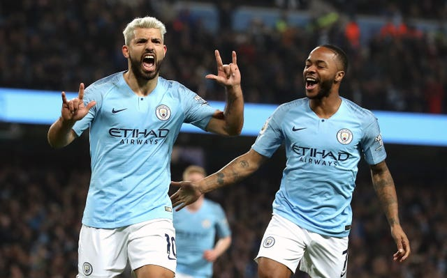 Sergio Aguero, left, celebrates with Raheem Sterling