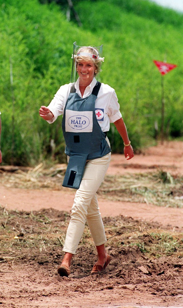 Diana, Princess of Wales walking through a minefield during a visit to Angola in January 1997 to see the work of the British Red Cross (John Stillwell/PA)