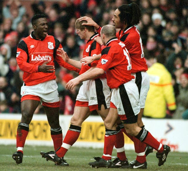 Stuart Pearce, centre left, celebrates with his Forest team-mates after scoring against Middlesbrough