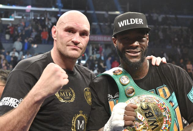 Tyson Fury, left, was unable to take Deontay Wilder's WBC heavyweight title after their meeting last December was scored a draw (Lionel Hahn/PA)