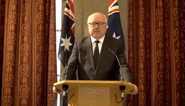 George Brandis speaking at a lectern