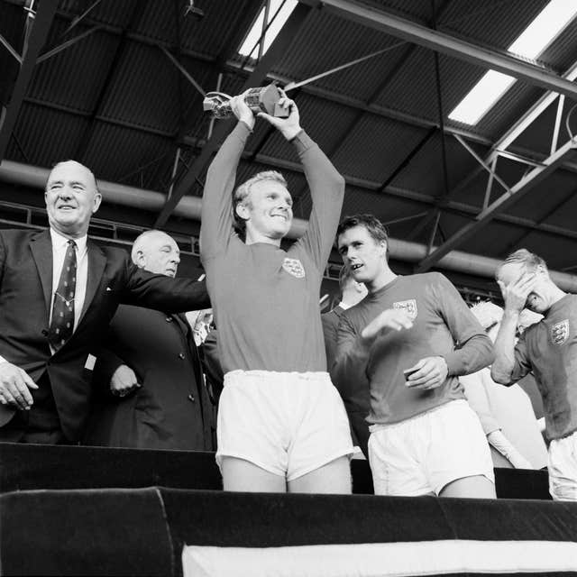 Bobby Moore lifts the Jules Rimet Trophy at Wembley Stadium (PA) in 1966.