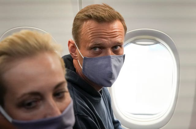 Alexei Navalny and his wife, Yulia, in the plane prior to their flight to Moscow