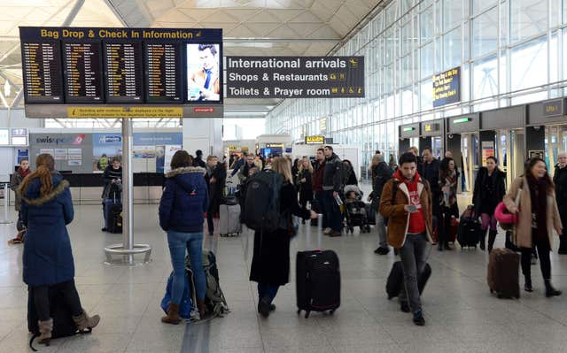 Checking in at the airport can lead to unexpected charges (Joe Giddens/PA)