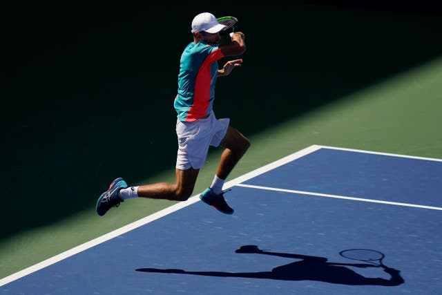 Alex De Minaur leaps into a return during his victory over Vasek Pospisil
