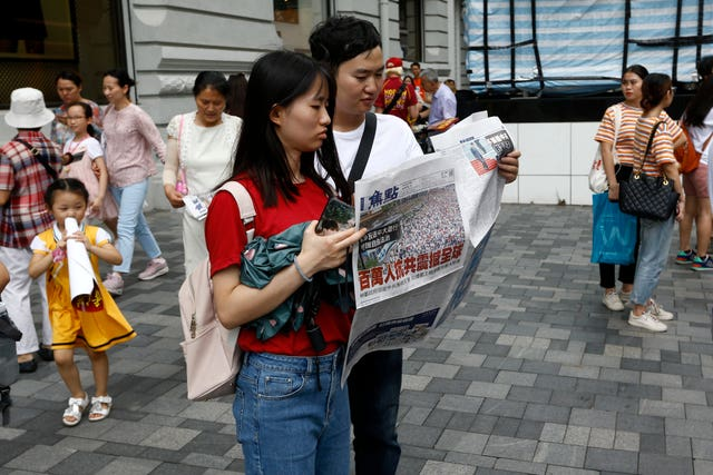Protesters are spreading their message at a high-speed rail station that connects the city to the mainland in China