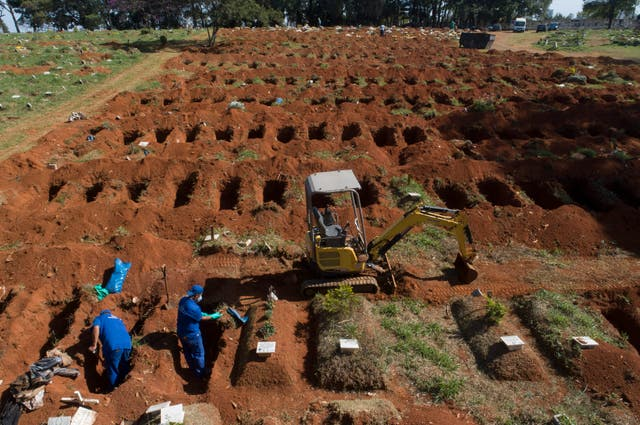Cemetery workers exhume remains buried three years ago at the Vila Formosa
