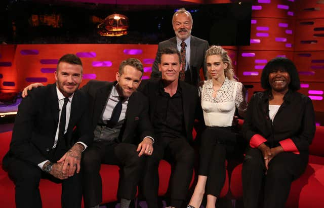 Graham Norton, with (seated left to right) David Beckham, Ryan Reynolds, Josh Brolin, Vanessa Kirby and Joan Armatrading (PA Images on behalf of So TV)