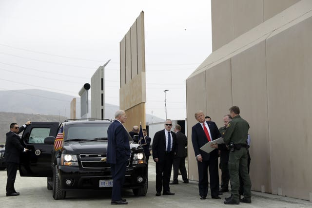 President Donald Trump reviews border wall prototypes (Evan Vucci/AP)