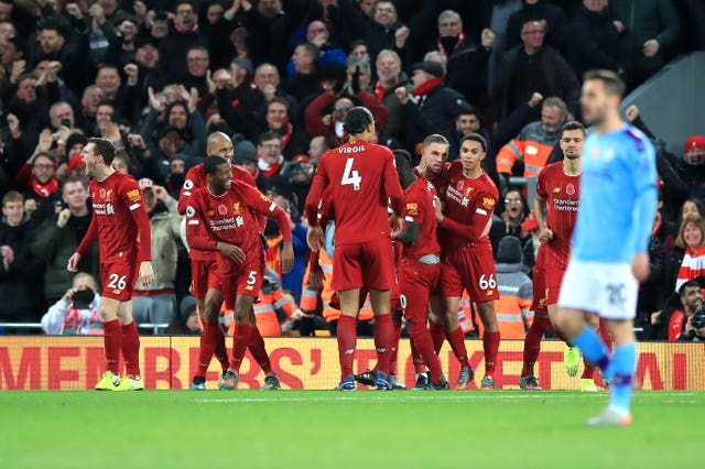Sadio Mane, centre right, celebrates scoring Liverpool's third goal against City at Anfield