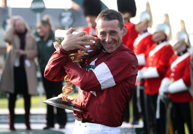 Davy Russell hugs the Grand National trophy