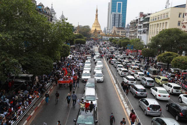 Protesters march near the Sule Pagoda in Yangon, Myanmar