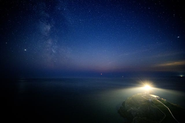The Milky Way seen behind South Stack lighthouse