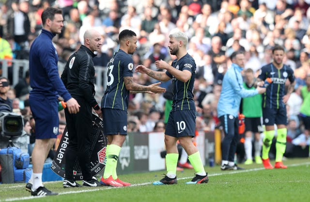 Sergio Aguero (right) is substituted for Gabriel Jesus at Fulham