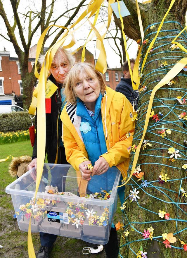 John and Barbara Ratcliffe, the parents of Richard Ratcliffe, help decorate a tree in Fortune Green in West Hampstead on the anniversary Nazanin Zaghari-Ratcliffe's detention