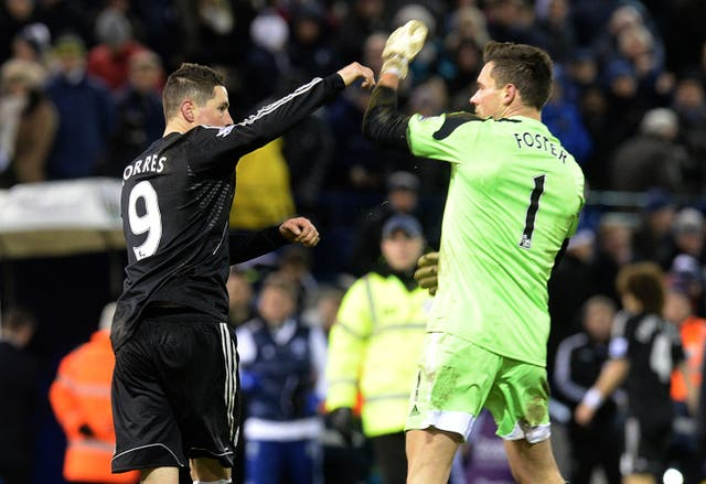 Torres (left) and West Brom goalkeeper Ben Foster have a dispute following a 1-1 draw at the Hawthorns