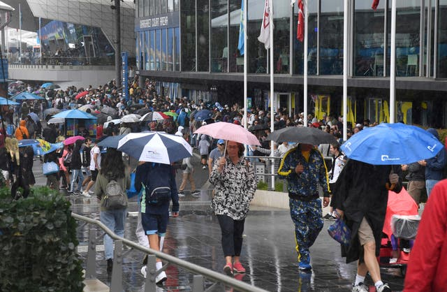 Umbrellas were the must-have accessory at a soggy Melbourne Park on Monday