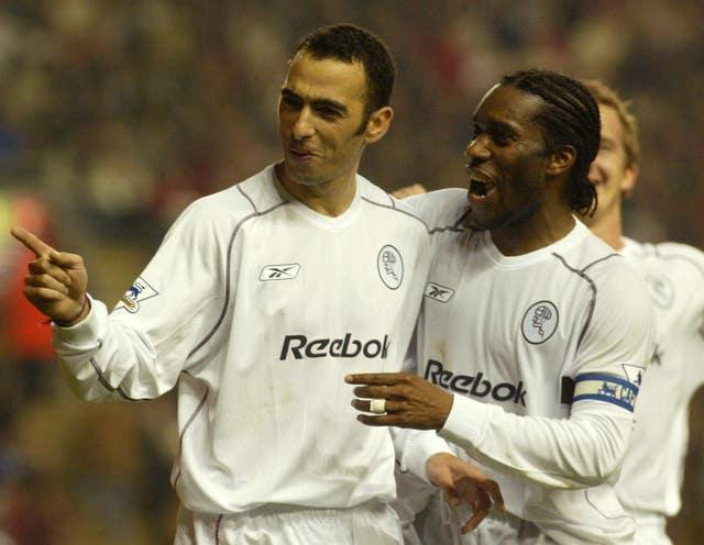 Bolton's Youri Djorkaeff, left, and Jay-Jay Okocha celebrate a goal against Liverpool