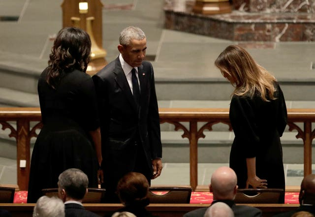 Former President Barack Obama and former first lady Michelle Obama greet first lady Melania Trump at the funeral service (David J Phillip/AP
