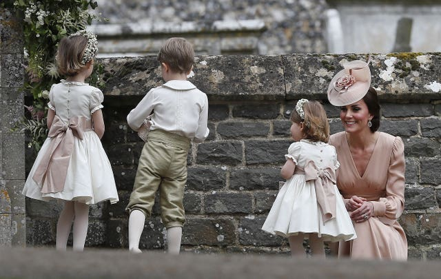The Duchess of Cambridge with her daughter Princess Charlotte after the wedding of Pippa Middleton (Kirsty Wigglesworth/PA)