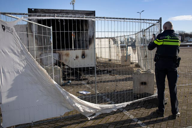 A torched coronavirus testing facility in the Dutch fishing village of Urk