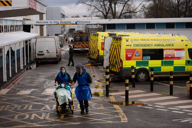 Ambulance crews transport patients into City Hospital in Birmingham (Jacob King/PA)