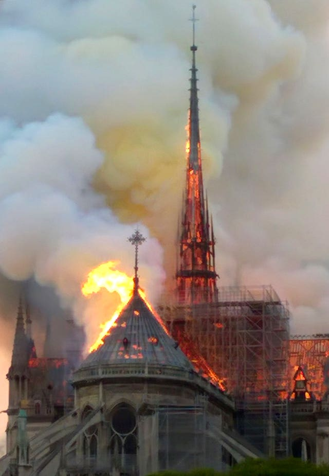 The spire and parts of Notre Dame cathedral on fire