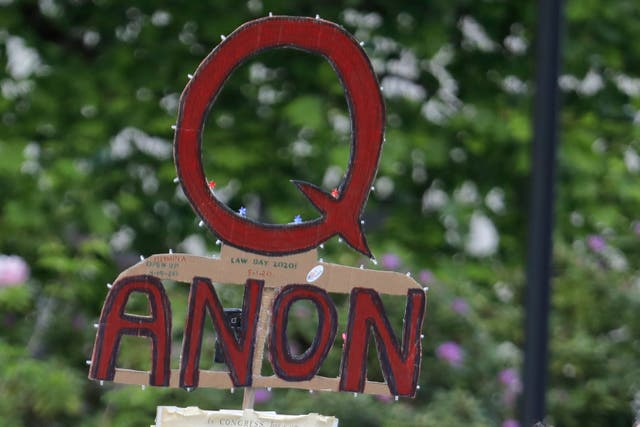 "Facebook will remove pages, groups and Instagram accounts for ""representing QAnon."""