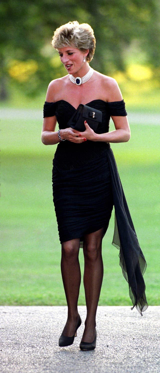 Diana, Princess of Wales wearing a black pleated chiffon dress, with floating side panel, by Christina Stamboulian, during a party given at the Serpentine Gallery in London.
