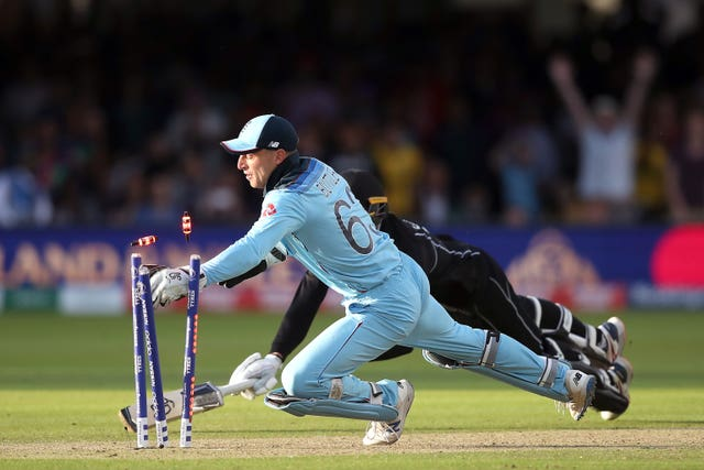 Jos Buttler scatters the stumps to run out New Zealand batsman Martin Guptill and help England's cricketers write their names in the history books at Lord's. Under the guidance of Trevor Bayliss, England won their first World Cup title in a final that will go down as one of the most dramatic ever produced in team sport. With the match tied after 50 overs each, a tense super over also finished level, with the hosts victorious on the boundary count back rule